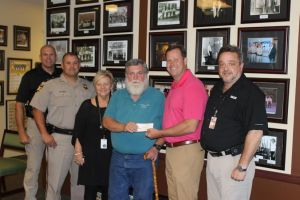 Sheriff's Auxiliary Donates to Winner's Club