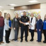 Calhoun Police Department makes donation to Edna Owens Breast Center at AdventHealth Gordon