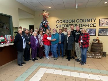 Sheriff's Auxiliary Helps 'Winner' Club' With Christmastime Needs