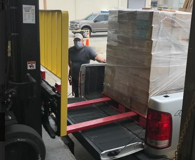 Georgia Power employees from Plant Bowen donate pallets of frozen food to local shelter
